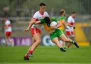11 July 2021; Ryan McHugh of Donegal is tackled by Shane McGuigan of Derry during the Ulster GAA Football Senior Championship Quarter-Final match between Derry and Donegal at Páirc MacCumhaill in Ballybofey, Donegal. Photo by Stephen McCarthy/Sportsfile