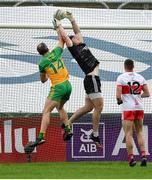 11 July 2021; Derry goalkeeper Oran Lynch in action against Michael Murphy of Donegal during the Ulster GAA Football Senior Championship Quarter-Final match between Derry and Donegal at Páirc MacCumhaill in Ballybofey, Donegal. Photo by Stephen McCarthy/Sportsfile