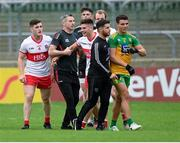 11 July 2021; Derry manager Rory Gallagher pulls his player Conor Doherty away from Odhran McFadden Ferry of Donegal at the half time break of the Ulster GAA Football Senior Championship Quarter-Final match between Derry and Donegal at Páirc MacCumhaill in Ballybofey, Donegal. Photo by Stephen McCarthy/Sportsfile