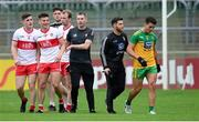 11 July 2021; Derry manager Rory Gallagher keeps his players away from Odhran McFadden Ferry of Donegal at the half time break of the Ulster GAA Football Senior Championship Quarter-Final match between Derry and Donegal at Páirc MacCumhaill in Ballybofey, Donegal. Photo by Stephen McCarthy/Sportsfile
