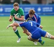 13 July 2021; Cathal Forde of Ireland is tackled by Matthias Haddad Victor of France during the U20 Six Nations Rugby Championship match between Ireland and France at Cardiff Arms Park in Cardiff, Wales. Photo by Mark Lewis/Sportsfile