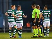 13 July 2021; Rory Gaffney, left, and Shamrock Rovers captain Ronan Finn protest to referee Mario Zebec after the UEFA Champions League first qualifying round second leg match between Shamrock Rovers and Slovan Bratislava at Tallaght Stadium in Dublin. Photo by Eóin Noonan/Sportsfile