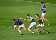 10 July 2021; Conor Bowe of Tipperary gets away from Seán O'Shea, and Micheál Burns, right, of Kerry during the Munster GAA Football Senior Championship Semi-Final match between Tipperary and Kerry at Semple Stadium in Thurles, Tipperary. Photo by Piaras Ó Mídheach/Sportsfile