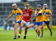 14 July 2021; Mikey Finn of Cork in action against Niall O Farrell, left, and Jack O Neill of Clare during the 2021 Electric Ireland Munster GAA Hurling Minor Championship Quarter-Final match between Clare and Cork at Semple Stadium in Thurles, Tipperary. Photo by Eóin Noonan/Sportsfile