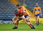 14 July 2021; Ross O'Sullivan of Cork in action against Niall O Farrell of Clare during the 2021 Electric Ireland Munster GAA Hurling Minor Championship Quarter-Final match between Clare and Cork at Semple Stadium in Thurles, Tipperary. Photo by Eóin Noonan/Sportsfile