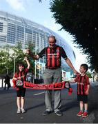 15 July 2021; Bohemians supporters Keith Kelly with Sarah and Aaron O'Toole, age six and four, from Celbridge, Kildare, before the UEFA Europa Conference League first qualifying round second leg match between Bohemians and Stjarnan at the Aviva Stadium in Dublin. Photo by Harry Murphy/Sportsfile