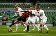 15 July 2021; Georgie Kelly of Bohemians in action against Magnus Clausen and Brynjar Gudjónsson of Stjarnan during the UEFA Europa Conference League first qualifying round second leg match between Bohemians and Stjarnan at the Aviva Stadium in Dublin. Photo by Harry Murphy/Sportsfile