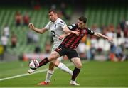 15 July 2021; Ali Coote of Bohemians in action against Elís Rafn Björnsson of Stjarnan during the UEFA Europa Conference League first qualifying round second leg match between Bohemians and Stjarnan at the Aviva Stadium in Dublin. Photo by Harry Murphy/Sportsfile