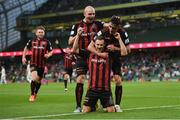 15 July 2021; Liam Burt of Bohemians is congratulated by team-mates Georgie Kelly, left, and Dawson Devoy after scoring their side's third goal during the UEFA Europa Conference League first qualifying round second leg match between Bohemians and Stjarnan at the Aviva Stadium in Dublin. Photo by Seb Daly/Sportsfile