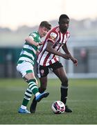 16 July 2021; Junior Ogedi-Uzokwe of Derry City in action against Ronan Finn of Shamrock Rovers during the SSE Airtricity League Premier Division match between Derry City and Shamrock Rovers at the Ryan McBride Brandywell Stadium in Derry. Photo by David Fitzgerald/Sportsfile
