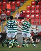 16 July 2021; Rory Gaffney of Shamrock Rovers, 20, is congratulated by team-mate Graham Burke after scoring his side's third goal during the SSE Airtricity League Premier Division match between Derry City and Shamrock Rovers at the Ryan McBride Brandywell Stadium in Derry. Photo by David Fitzgerald/Sportsfile