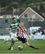 16 July 2021; Graham Burke of Shamrock Rovers in action against Ciaron Harkin of Derry City during the SSE Airtricity League Premier Division match between Derry City and Shamrock Rovers at the Ryan McBride Brandywell Stadium in Derry. Photo by David Fitzgerald/Sportsfile