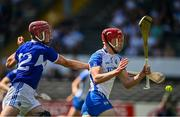 17 July 2021; Calum Lyons of Waterford is hooked by Ciaran Collier of Laois during the GAA Hurling All-Ireland Senior Championship Round 1 match between Laois and Waterford at UPMC Nowlan Park in Kilkenny. Photo by Harry Murphy/Sportsfile