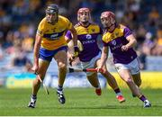 17 July 2021; Cathal Malone of Clare in action against Lee Chin, left, and Cathal Dunbar of Wexford during the GAA Hurling All-Ireland Senior Championship Round 1 match between Clare and Wexford at Semple Stadium in Thurles, Tipperary. Photo by Piaras Ó Mídheach/Sportsfile