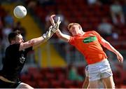 17 July 2021; Conor Turbitt of Armagh scores his side's first goal despite the efforts of Monaghan goalkeeper Rory Beggan during the Ulster GAA Football Senior Championship Semi-Final match between Armagh and Monaghan at Páirc Esler in Newry, Down. Photo by Ramsey Cardy/Sportsfile
