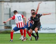 16 July 2021; Evan Caffrey of UCD in action against Matt Keane, and Clyde O'Connell of Treaty United during the SSE Airtricity League First Division match between Treaty United and UCD at Market's Field in Limerick. Photo by Michael P Ryan/Sportsfile