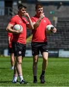 18 July 2021; Tyrone players Richard Donnelly, left, and Cathal McShane walk the pitch before the Ulster GAA Football Senior Championship Semi-Final match between Donegal and Tyrone at Brewster Park in Enniskillen, Fermanagh. Photo by Sam Barnes/Sportsfile