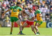 18 July 2021; Kieran McGeary of Tyrone in action against Michael Langan, left, and Odhran McFadden Ferry of Donegal during the Ulster GAA Football Senior Championship Semi-Final match between Donegal and Tyrone at Brewster Park in Enniskillen, Fermanagh. Photo by Sam Barnes/Sportsfile