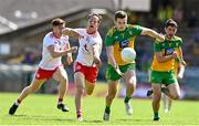 18 July 2021; Eoghan Ban Gallagher of Donegal in action against Kieran McGeary of Tyrone during the Ulster GAA Football Senior Championship Semi-Final match between Donegal and Tyrone at Brewster Park in Enniskillen, Fermanagh. Photo by Sam Barnes/Sportsfile