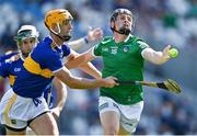 18 July 2021; Peter Casey of Limerick is tackled by Barry Heffernan of Tipperary during the Munster GAA Hurling Senior Championship Final match between Limerick and Tipperary at Páirc Uí Chaoimh in Cork. Photo by Piaras Ó Mídheach/Sportsfile