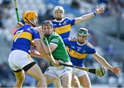 18 July 2021; Peter Casey of Limerick in action against Tipperary players, from left, Barry Heffernan, Brendan Maher and Cathal Barrett during the Munster GAA Hurling Senior Championship Final match between Limerick and Tipperary at Páirc Uí Chaoimh in Cork. Photo by Piaras Ó Mídheach/Sportsfile