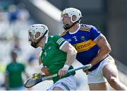 18 July 2021; Cian Lynch of Limerick is tackled by Pádraic Maher of Tipperary during the Munster GAA Hurling Senior Championship Final match between Limerick and Tipperary at Páirc Uí Chaoimh in Cork. Photo by Piaras Ó Mídheach/Sportsfile