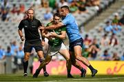 18 July 2021; Bryan McMahon of Meath is tackled by James McCarthy of Dublin during the Leinster GAA Senior Football Championship Semi-Final match between Dublin and Meath at Croke Park in Dublin. Photo by Harry Murphy/Sportsfile