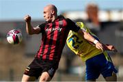 18 July 2021; Georgie Kelly of Bohemians in action against Joe Manley of Longford Town during the SSE Airtricity League Premier Division match between Bohemians and Longford Town at Dalymount Park in Dublin. Photo by Michael P Ryan/Sportsfile
