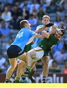 18 July 2021; Cillian O'Sullivan of Meath is tackled by Con O'Callaghan, left, and Jonny Cooper of Dublin during the Leinster GAA Senior Football Championship Semi-Final match between Dublin and Meath at Croke Park in Dublin. Photo by Eóin Noonan/Sportsfile