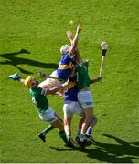 18 July 2021; Séamus Flanagan, left, and Conor Boylan of Limerick in action against Pádraic Maher, left, and Séamus Kennedy of Tipperary during the Munster GAA Hurling Senior Championship Final match between Limerick and Tipperary at Páirc Uí Chaoimh in Cork. Photo by Daire Brennan/Sportsfile