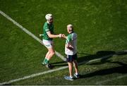 18 July 2021; Limerick manager John Kiely fist bumps Cian Lynch of Limerick as he leaves the field near the end of the Munster GAA Hurling Senior Championship Final match between Limerick and Tipperary at Páirc Uí Chaoimh in Cork. Photo by Daire Brennan/Sportsfile