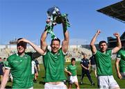 18 July 2021; Dan Morrissey of Limerick celebrates with the cup, alongside team-mates Declan Hannon, left, and Barry Nash after the Munster GAA Hurling Senior Championship Final match between Limerick and Tipperary at Páirc Uí Chaoimh in Cork. Photo by Piaras Ó Mídheach/Sportsfile