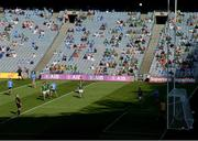 18 July 2021; Cormac Costello of Dublin kicks a point late in the game as Dublin and Meath players and supporters look on during the Leinster GAA Senior Football Championship Semi-Final match between Dublin and Meath at Croke Park in Dublin. Photo by Harry Murphy/Sportsfile