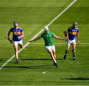 18 July 2021; Kyle Hayes of Limerick celebrates scoring his side's second goal , in the 54th minute, as John O'Dwyer, 12, and Cathal Barrett of Tipperary look on, during the Munster GAA Hurling Senior Championship Final match between Limerick and Tipperary at Páirc Uí Chaoimh in Cork. Photo by Ray McManus/Sportsfile