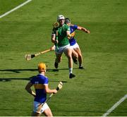 18 July 2021; Kyle Hayes of Limerick shoots past Dan McCormack of Tipperary as he scores his side's second goal , in the 54th minute, as Barry Heffernan of Tipperary looks on during the Munster GAA Hurling Senior Championship Final match between Limerick and Tipperary at Páirc Uí Chaoimh in Cork. Photo by Ray McManus/Sportsfile