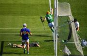 18 July 2021; An umpire reaches for a green flag as Séamus Flanagan of Limerick celebrates scoring a goal in the 42nd minute during the Munster GAA Hurling Senior Championship Final match between Limerick and Tipperary at Páirc Uí Chaoimh in Cork. Photo by Ray McManus/Sportsfile