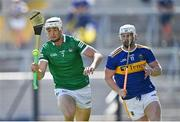 18 July 2021; Kyle Hayes of Limerick gets past Michael Breen of Tipperary during the Munster GAA Hurling Senior Championship Final match between Limerick and Tipperary at Páirc Uí Chaoimh in Cork. Photo by Piaras Ó Mídheach/Sportsfile