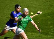 18 July 2021; Cian Lynch of Limerick is tackled by Dan McCormack of Tipperary  during the Munster GAA Hurling Senior Championship Final match between Limerick and Tipperary at Páirc Uí Chaoimh in Cork. Photo by Ray McManus/Sportsfile