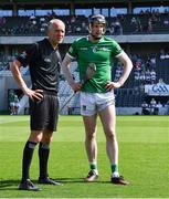 18 July 2021; Limerick captain Declan Hannon and linesman Cathal McAllister await the coin toss before the Munster GAA Hurling Senior Championship Final match between Limerick and Tipperary at Páirc Uí Chaoimh in Cork. Photo by Piaras Ó Mídheach/Sportsfile