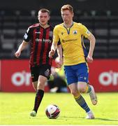 18 July 2021; Darragh Nugent of Longford Town in action against Robbie Mahon of Bohemians during the SSE Airtricity League Premier Division match between Bohemians and Longford Town at Dalymount Park in Dublin. Photo by Michael P Ryan/Sportsfile