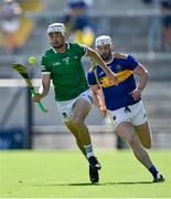 18 July 2021; Kyle Hayes of Limerick gets away from Michael Breen of Tipperary during the Munster GAA Hurling Senior Championship Final match between Limerick and Tipperary at Páirc Uí Chaoimh in Cork. Photo by Piaras Ó Mídheach/Sportsfile