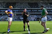 18 July 2021; Referee Paud O'Dwyer performs the coin toss with Tipperary captain Séamus Callanan and Limerick captain Declan Hannon before the Munster GAA Hurling Senior Championship Final match between Limerick and Tipperary at Páirc Uí Chaoimh in Cork. Photo by Piaras Ó Mídheach/Sportsfile