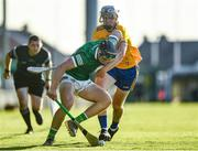 19 July 2021; Aidan Moriarty of Clare in action against Aidan O'Connor of Limerick during the Munster GAA Hurling U20 Championship semi-final match between Limerick and Clare at the LIT Gaelic Grounds in Limerick. Photo by Ben McShane/Sportsfile