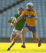 19 July 2021; Adam Hogan of Clare in action against Bryan Nix of Limerick during the Munster GAA Hurling U20 Championship semi-final match between Limerick and Clare at the LIT Gaelic Grounds in Limerick. Photo by Ben McShane/Sportsfile