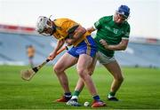 19 July 2021; Adam Hogan of Clare in action against Aidan O'Connor of Limerick during the Munster GAA Hurling U20 Championship semi-final match between Limerick and Clare at the LIT Gaelic Grounds in Limerick. Photo by Ben McShane/Sportsfile
