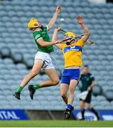 19 July 2021; Cathal O'Neill of Limerick in action against Paddy Donnellan of Clare during the Munster GAA Hurling U20 Championship semi-final match between Limerick and Clare at the LIT Gaelic Grounds in Limerick. Photo by Ben McShane/Sportsfile