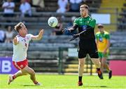 18 July 2021; Donegal goalkeeper Shaun Patton in action against Kieran McGeary of Tyrone during the Ulster GAA Football Senior Championship Semi-Final match between Donegal and Tyrone at Brewster Park in Enniskillen, Fermanagh. Photo by Sam Barnes/Sportsfile