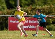 20 July 2021; Chloe Savage, age 11, in action during the Bank of Ireland Leinster Rugby Summer Camp at Balbriggan RFC in Dublin. Photo by Matt Browne/Sportsfile