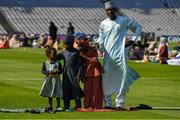 20 July 2021; The Musa family of Zainab, left, Abdullahi, Fatima and dad Masoud, from Nigeria, on the pitch during the celebration of Eid Al-Adha at Croke Park in Dublin. Photo by Ray McManus/Sportsfile
