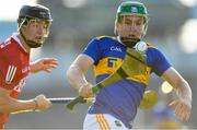 20 July 2021; James Devanney of Tipperary in action against Eoin Downey of Cork during the Munster GAA Hurling U20 Championship semi-final match between Tipperary and Cork at Semple Stadium in Thurles, Tipperary. Photo by Ben McShane/Sportsfile